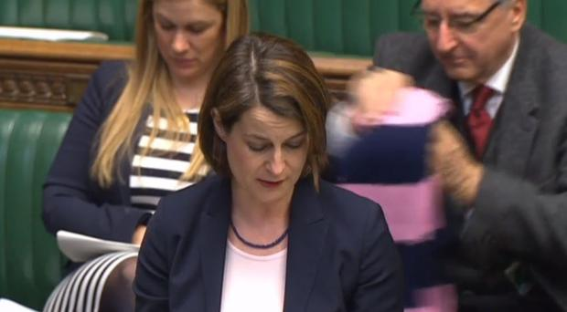 Labour's Helen Hayes speaks in the Commons, with a pink and navy blue Dulwich Hamlet scarf in the background