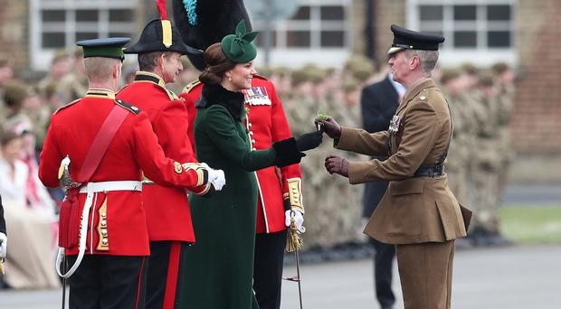 The Duchess of Cambridge presents shamrock to officers and guardsmen of 1st Battalion the Irish Guards (Jonathan Brady/PA)