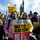 People take part in an anti-racism rally in Glasgow organised by Stand up to Racism Scotland (Mark Runnacles/PA)