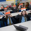 Pupils from St John's Primary in Barrhead try out the new virtual reality headsets (ERC/PA)