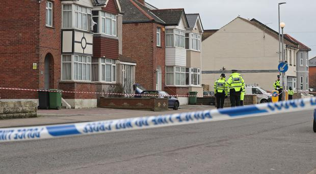 Police at the scene where two women were shot dead at a house in St Leonards (Gareth Fuller/PA)