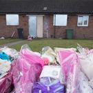 Floral tributes in remembrance of Mylee Billingham outside the property in Brownhills, near Walsall, where the eight-year-old was found with fatal knife wounds (Aaron Chown/PA)