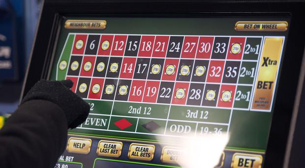 Someone using a gambling machine (Daniel Hambury/PA)