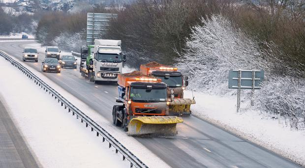 Snowploughs on the A30 near Okehampton in Devon, which was hit by 'significant snow' (Martin Keene/PA)