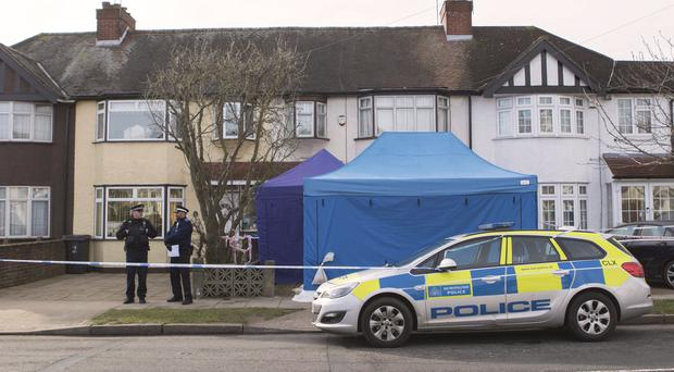 Police outside the home of Nikolai Glushkov in New Malden (Rick Findler/PA)