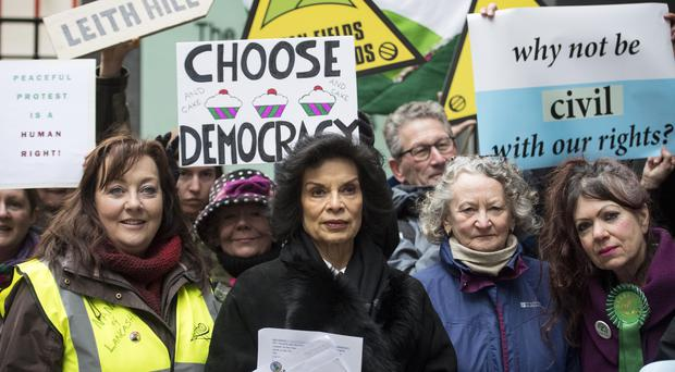 Bianca Jagger and environmental protesters outside the High Court in London (Victoria Jones/PA)