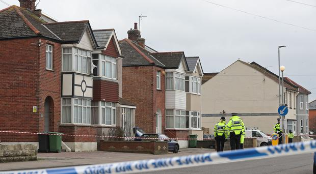 Police at the scene where the two women were shot dead (Gareth Fuller/PA)