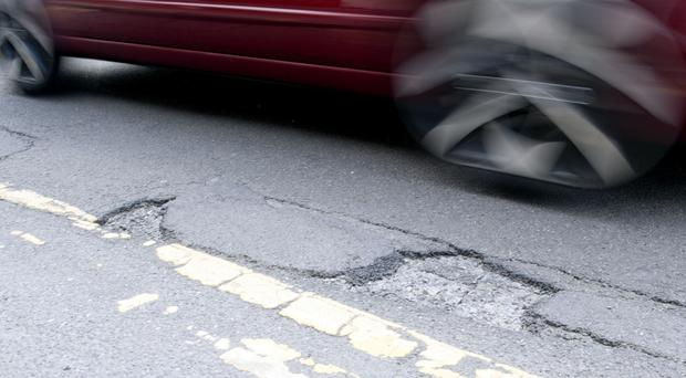 Councils filled 1.5 million potholes in the past year (Tim Goode/PA)