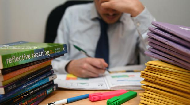 Teachers work longer hours in term time and have had a bigger drop in pay than nurses and police officers, according to a study (PA)
