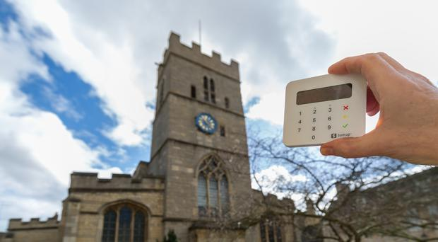 The Church of England is introducing contactless payment devices to 16,000 locations.