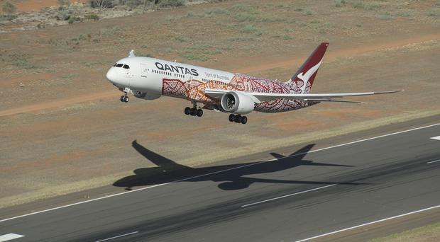 Qantas will set a new record for the longest non-stop scheduled passenger flight from a UK airport (Qantas/PA)