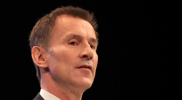 Jeremy Hunt has indicated there will be a cap on care costs (Peter Byrne/PA)