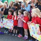 The Duchess of Cornwall meets nursery school children during a visit to Northern Ireland. At that age, children already care about their reputations, say experts. (Niall Carson/PA)