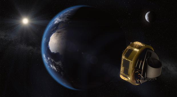 Artist's impression of the Ariel space telescope. ( ESA/STFC RAL space/UCL/Europlanet-Science Office/PA)