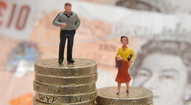Of the firms to have reported back so far, more than three-quarters have a median gender pay gap in favour of men (Joe Giddens/PA)