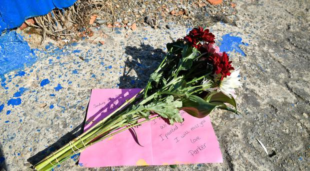 Flowers left beside a slipway leading to the River Teifi in Cardigan, Wales, near the scene where two-year-old Kiara Moore was recovered from a car that had plunged into the river (Ben Birchall/PA)