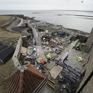 Restoration work is carried out on Lindisfarne Castle on Holy Island, in Northumberland (Owen Humphreys/PA)