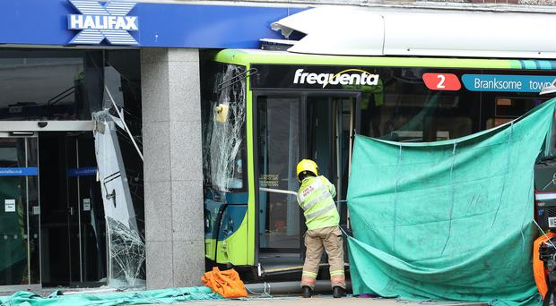 The scene in Darlington where an elderly female pedestrian died after a bus crashed into a Halifax Bank branch (Owen Humphreys/PA)