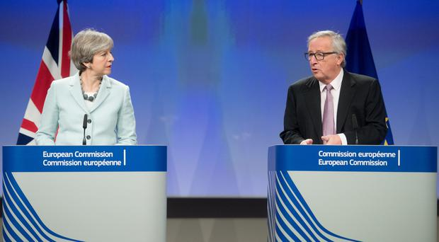 Theresa May with EU President Jean-Claude Juncker (Etienne Ansotte/EU)