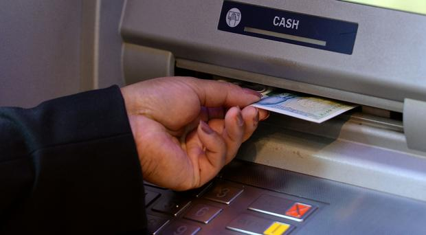 The Scottish Affairs Committee will hold a one-off session on bank machines in Scotland (Joe Giddens/PA)