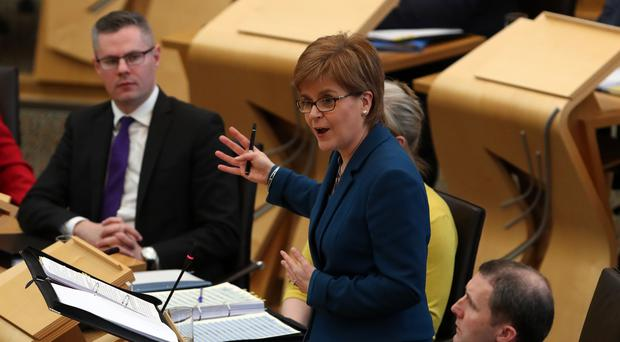 Nicola Sturgeon defended Scottish Govenrment efforts to close the attainmnet gap in schools at First Minister's Questions (Andrew Milligan/PA)