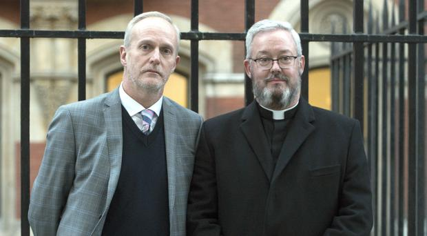 Canon Jeremy Pemberton and husband Laurence Cunnington (David Mirzoeff/PA)