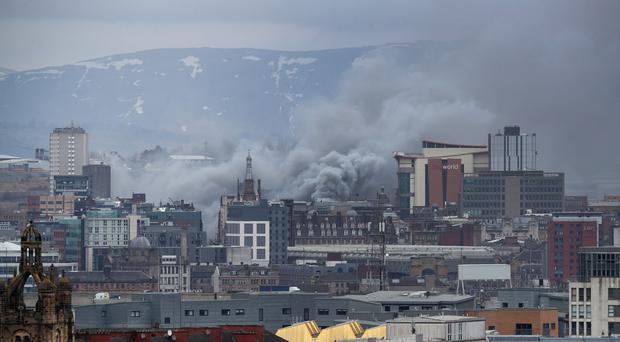 The view from Queen's Park of the scene in Glasgow city centre where firefighters tackled a large blaze on Sauchiehall Street (Jane Barlow/PA)