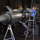 Silke Lohmann of Summers Place Auctions prepares a Cold War SA-4 Ganef Russian missile in their Home and Garden Conversation Pieces auction (Gareth Fuller/PA)
