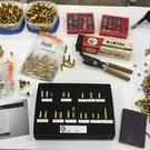 Some of the pistols and ammunition recovered by officers after they raided illicit firearms dealer Kevin Bates' Birmingham home. (Richard Vernalls/PA)
