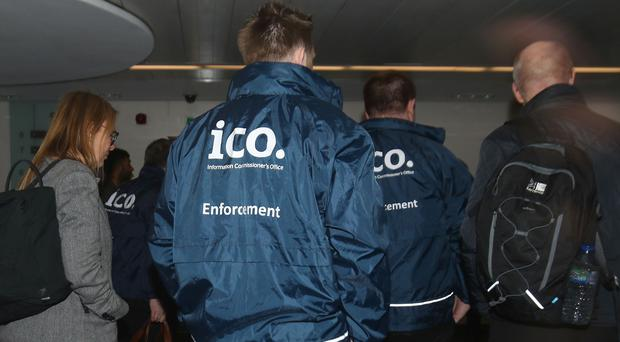 Enforcement officers working for the Information Commissioner's Office entering the premises of Cambridge Analytica in central London (Yui Mok/PA)