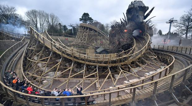 Visitors ride the Wicker Man, a wooden roller coaster which features a six-storey flaming structure, at Alton Towers in Stoke-on-Trent (Anthony Devlin/PA)