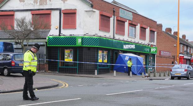 Police at the scene ofPaddy Power in Rookery Road, Birmingham, following a fatal stabbing (Matthew Cooper/PA)