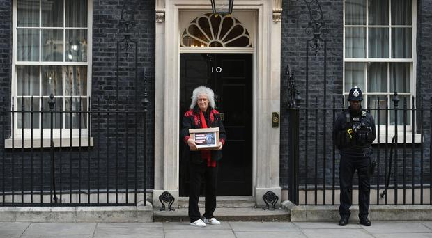 Queen guitarist Brian May has handed in a petition at 10 Downing Street urging Prime Minister Theresa May to introduce a UK animal fur import ban (Stefan Rousseau/PA)