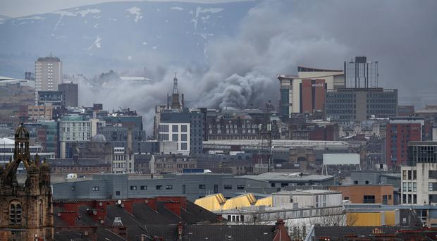 More than 120 firefighters fought flames at the height of the fire (Jane Barlow/PA)
