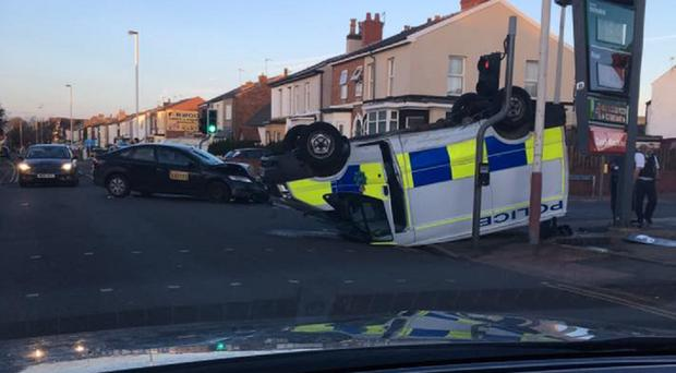 The van was flipped on to its roof after the crash in Southport (Sarah Marie O'Callaghan)