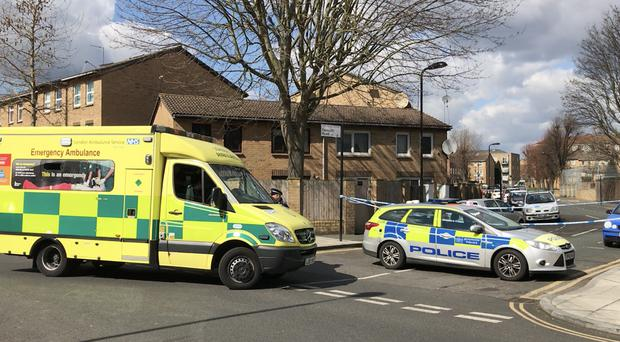 Emergency personnel near to the scene on Ferncliff Road in Hackney, east London, where a 26-year-old man has died after he was gunned down shortly after 11pm on Sunday (Jamie Johnson/PA)