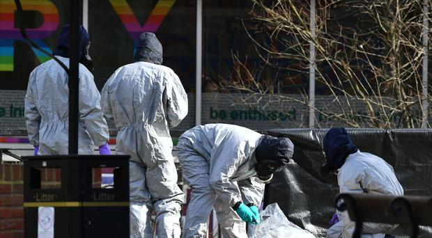 Police in protective suits at The Maltings shopping centre, where former Russian double agent Sergei Skripal and his daughter Yulia were found critically ill (Ben Birchall/PA)