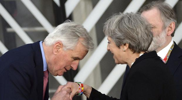 EU chief Brexit negotiator Michel Barnier greets Theresa May at a summit in Brussels (AP Photo/Aleksiej Witwicki)