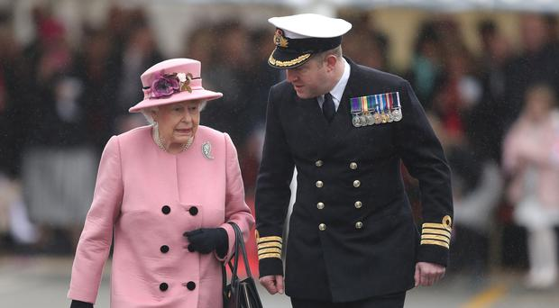 The Queen and Captain Rob Pedre (Andrew Matthews/PA)