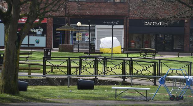 A police tent in Salisbury covering a bench by The Maltings shopping centre (Ben Birchall/PA)