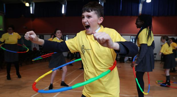 Pupils took part in hula hoop competition at Holyrood Secondary School in Glasgow (Andrew Milligan/PA)