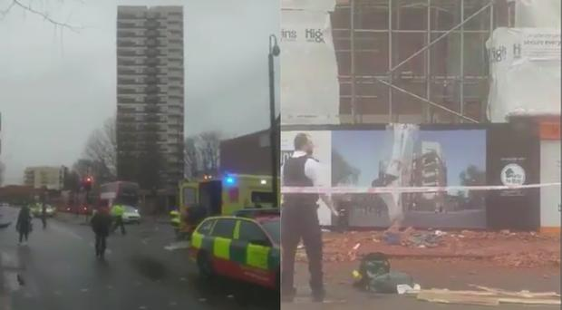 A woman lies in a critical condition after being struck by falling debris in east London (Rohan Khan/Twitter)