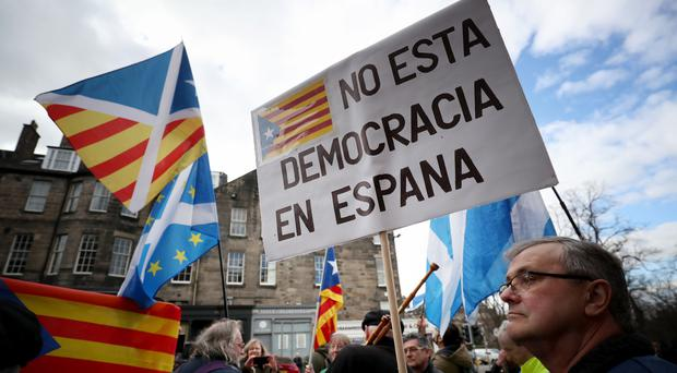 Catalan ex-minister surrenders to police in Scotland