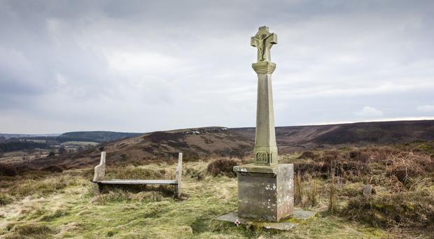 A memorial in North Yorkshire to Francis Titcomb, aged 19, where he crashed in April 1917 is among those getting protected status (Historic England/PA)