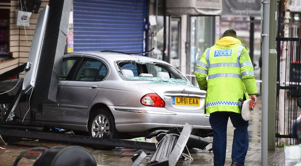 The scene in Golders Green in north London where a car crashed into a pharmacy (Kirsty O'Connor/PA)