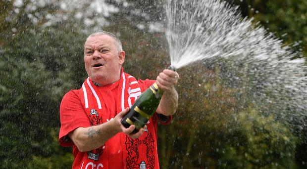 Father of three and life-long Leyton Orient fan from Wickford, Paul Long, celebrates winning a fortune (Joe Giddens/PA)