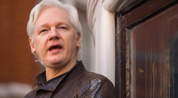 Julian Assange is said to have lost internet access (Dominic Lipinski/PA)