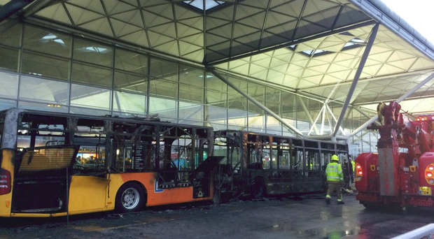 A passenger shuttle bus caught alight this evening at Stansted Airport (@Zsofia_MCR/PA)