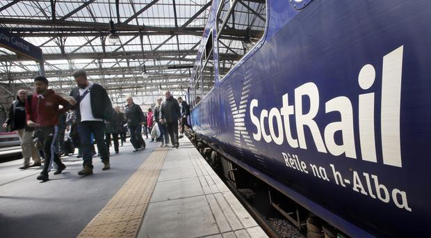 A commute between Edinburgh and Glasgow could cost about £380 a month (Danny Lawson/PA)