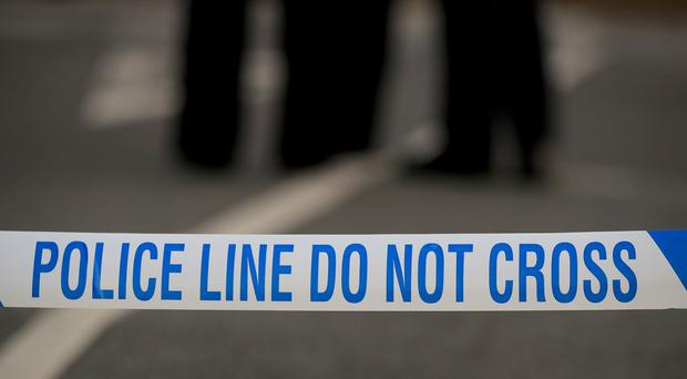 File photo of police tape (Peter Byrne/PA)